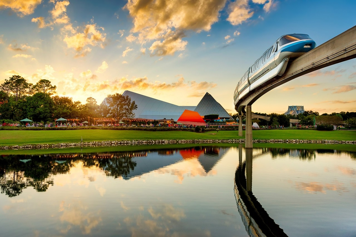 The Blue Monorail Sails Through an Epcot Sunset